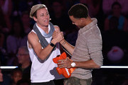 NBA player Stephen Curry (R) celebrates his Clutch Player of the Year win with U.S. Women's Soccer player Abby Wambach onstage at the Nickelodeon Kids' Choice Sports Awards 2015 at UCLA's Pauley Pavilion on July 16, 2015 in Westwood, California.