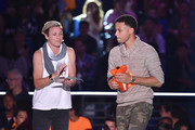 NBA player Stephen Curry (R) accepts the Sickest Moves award from U.S. Women's Soccer player Abby Wambach onstage at the Nickelodeon Kids' Choice Sports Awards 2015 at UCLA's Pauley Pavilion on July 16, 2015 in Westwood, California.