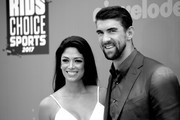 Image has been converted to black and white.) Model-Miss California USA 2010 Nicole Johnson (L) and honoree Michael Phelps attend Nickelodeon Kids' Choice Sports Awards 2017 at Pauley Pavilion on July 13, 2017 in Los Angeles, California.