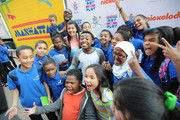Amani Toomer,  Amani Toomer Jr, Jasmine Toomer, Amber Montana, Breanna Yde, Benjamin Flores Jr and Curtis Harris Jr attend the NYRoad Runner Club in Times Square host Nickelodeon themed 5 borough relay race on September 20, 2013 in New York City.