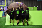 (L-R) Actor Ricardo Hurtado, NFL players Luke Kuechly, Stefon Diggs and former NFL player Deion Sanders attend the Superstar Slime Showdown taping at Nickelodeon at the Super Bowl Experience on February 1, 2018 in Minneapolis, Minnesota.