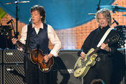 (L-R) Musicians Paul McCartney and Brian Ray perform onstage during 'The Night That Changed America: A GRAMMY Salute To The Beatles' at the Los Angeles Convention Center on January 27, 2014 in Los Angeles, California.