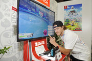 Blake Anderson checks out 'Pokémon Sword and Pokémon Shield' for the Nintendo Switch system during the 2019 E3 Gaming Convention at Los Angeles Convention Center on June 12, 2019 in Los Angeles, California.