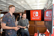 Bill Skarsgard (L) and Dustin Thomason test their skills on Super Smash Bros. Ultimate for Nintendo Switch at the Variety Studio at Comic-Con 2018 on July 20, 2018 in San Diego, CA.