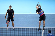 Bruno Soares of Brazil and Jamie Murray of Great Britain return the ball in their doubles semi finals match against Mike Bryan and Jack Sock of The United States during Day Seven of the Nitto ATP Finals at The O2 Arena on November 17, 2018 in London, England.
