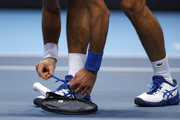 Novak Djokovic of Serbia ties his shoe lace his singles semi final match against Dominic Thiem of Austria during day seven of the Nitto ATP World Tour Finals at The O2 Arena on November 21, 2020 in London, England.