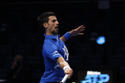 Novak Djokovic of Serbia plays a forehand during his singles semi final match against Dominic Thiem of Austria during day seven of the Nitto ATP World Tour Finals at The O2 Arena on November 21, 2020 in London, England.