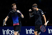 Jamie Murray of Great Britain and Brunro Soares of Brazil celebrate set point during doubles round robin match against Juan Sebastian Cabal of Columbia and Robert Farah of Columbia during Day Three of the Nitto ATP Finals at The O2 Arena on November 13, 2018 in London, England.