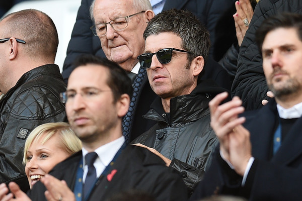 Manchester City v Arsenal - Premier League [people,facial expression,event,crowd,photography,selfie,bodyguard,gesture,team,noel gallagher,v,c,use,seat,british,premier league,manchester city,arsenal,football match]