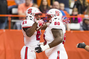 Matthew Dayes #21 nd Tony Adams #50 of the North Carolina State Wolfpack celebrate a touchdown during the fourth quarter against the Syracuse Orange on November 12, 2016 at The Carrier Dome in Syracuse, New York.