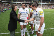 The Princess Royal is introduced by Saracens team captain Brad Barritt to Alex Goode during the Aviva Premiership match between Northampton Saints and Saracens at StadiumMK on April 25, 2015 in Milton Keynes, England.