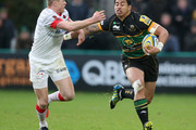 George Pisi of Northampton is tackled by Chris Ashton during the Aviva Premiership match between Northampton Saints and Saracens at Franklin's Gardens on October 27, 2012 in Northampton, England.
