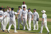Chris Wright of Warwickshire celebrates with team mates after taking the wicket of Alex Wakely during the Specsavers County Championship division two match between Northamptonshire and Warwickshire at The County Ground on April 20, 2018 in Northampton, England.