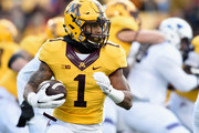 Rodney Smith #1 of the Minnesota Golden Gophers carries the ball against the Northwestern Wildcats during the first quarter of the game on November 19, 2016 at TCF Bank Stadium in Minneapolis, Minnesota.