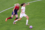 Jill Scott of England runs with the ball under pressure from Karina Saevik of Norway during the 2019 FIFA Women's World Cup France Quarter Final match between Norway and England at Stade Oceane on June 27, 2019 in Le Havre, France.