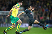 Grant Hanley of Norwich City and Pedro of Chelsea during the The Emirates FA Cup Third Round match between Norwich City and Chelsea at Carrow Road on January 6, 2018 in Norwich, England.