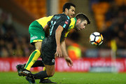 Grant Hanley of Norwich City challenges Pedro of Chelsea during The Emirates FA Cup Third Round match between Norwich City and Chelsea at Carrow Road on January 6, 2018 in Norwich, England.