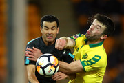 Grant Hanley of Norwich City is challenged by Pedro of Chelsea during The Emirates FA Cup Third Round match between Norwich City and Chelsea at Carrow Road on January 6, 2018 in Norwich, England.