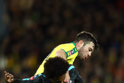Grant Hanley of Norwich City tackles Willian of Chelsea during the The Emirates FA Cup Third Round match between Norwich City and Chelsea at Carrow Road on January 6, 2018 in Norwich, England.