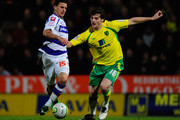 Chris Martin of Norwich City battes with Kyle Walker of Queens Park Rangers during the npower Championship match between Norwich City and Queens Park Rangers at Carrow Road on January 1, 2011 in Norwich, England.
