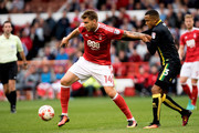 Nicklas Bendtner of Nottingham Forest and Martin Olsson of Norwich in action during the Sky Bet Championship match between Nottingham Forest and Norwich City on September 17, 2016 in Nottingham, England.