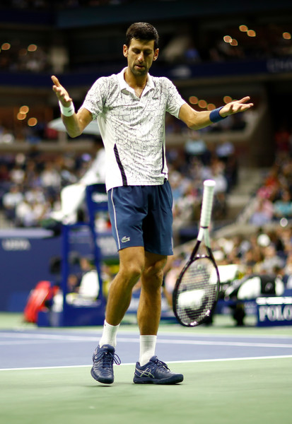 2018 US Open - Day 12 [tennis,sports,racquet sport,tennis player,championship,badminton,competition event,racket,tournament,sports equipment,novak djokovic,kei nishikori,day twelve,serbia,neighborhood,japan,borough,flushing,us open,mens singles semi-final match]
