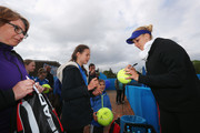 Sabine Lisicki of Germany signs autographs after a training session on Day One of the Nuernberger Versicherungscup 2016 on May 14, 2016 in Nuremberg, Bavaria.