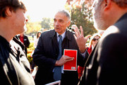 Political activist and former presidential candidate Ralph Nader talks with labor leaders before addressing hundreds of members of National Nurses United and their supporters during a rally in Laffayette Square across from the White House before marching to the U.S. Treasury Department November 3, 2011 in Washington, DC. In the spirit of the Occupy Wall Street movement, members of various labor unions with the AFL-CIO joined the nurses in their call to tax financial transactions on Wall Street and around the world as a way of reducing the national debt.