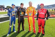 (L-R) Chase Elliott, driver of the #9 NAPA Auto Parts Chevrolet, Ty Dillon, driver of the #3 Bass Pro Shops Chevrolet, Brian Scott, driver of the #2 Country Bob's Sauce Chevrolet, and Regan Smith, driver of the #7 TaxSlayer.com Chevrolet, pose prior to the NASCAR Nationwide Series O'Reilly Auto Parts Challenge at Texas Motor Speedway on November 1, 2014 in Fort Worth, Texas.