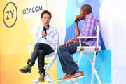 Malcolm Gladwell (L) and Carlos Watson speak onstage during OZY Fest 2018 at Rumsey Playfield, Central Park on July 22, 2018 in New York City.