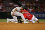 Marcus Semien #10 of the Oakland Athletics is late with the tag on Daniel Nava #25 of the Los Angeles Angels of Anaheim at second base during the fourth inning of a baseball game at Angel Stadium of Anaheim on June 23, 2016 in Anaheim, California.