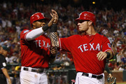 Josh Hamilton #32 of the Texas Rangers and Elvis Andrus #1 congratulate each other for scoring on a two run single hit by David Murphy #7 in the fifth inning against the Oakland Athletics at Rangers Ballpark in Arlington on June 28, 2012 in Arlington, Texas.