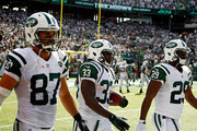 Chris Ivory #33 of the New York Jets walks back with teammates  Eric Decker #87 and  Bilal Powell #29 after a fourth quarter touchdown run against the Oakland Raiders at MetLife Stadium on September 7, 2014 in East Rutherford, New Jersey.