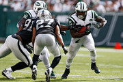Chris Ivory #33 of the New York Jets rushes the ball against  Justin Tuck #91 and  Carlos Rogers #27 of the Oakland Raiders during the third quarter at MetLife Stadium on September 7, 2014 in East Rutherford, New Jersey.