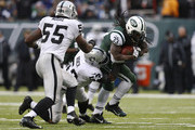 Nick Roach #53 of the Oakland Raiders takes down Chris Ivory #33 of the New York Jets during their game at MetLife Stadium on December 8, 2013 in East Rutherford, New Jersey.