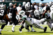 Chris Ivory #33 of the New York Jets rushes the ball against the Oakland Raiders during the first quarter at MetLife Stadium on September 7, 2014 in East Rutherford, New Jersey.