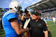 Philip Rivers #17 of the Los Angeles Chargers talks with head coach Jon Gruden of the Oakland Raiders after a game at StubHub Center on October 7, 2018 in Carson, California.  The Los Angeles Chargers defeated the Oakland Raiders 26-10.