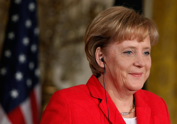 German Chancellor Angela Merkel takes questions from reporters with