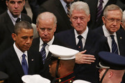 (L-R) President Barack Obama, Vice President Joseph Biden, former U.S. President Bill Clinton and House Majority Leader Rep. Harry Reid (D-NV) watch as the casket of Sen. Daniel Inouye (D-HI) is carried past during a funeral service at the National Cathedral on December 21, 2012 in Washington, DC. Sen. Inouye, who was the most senior senator and a Medal of Honor recipient, died on December 17 at the age of 88.
