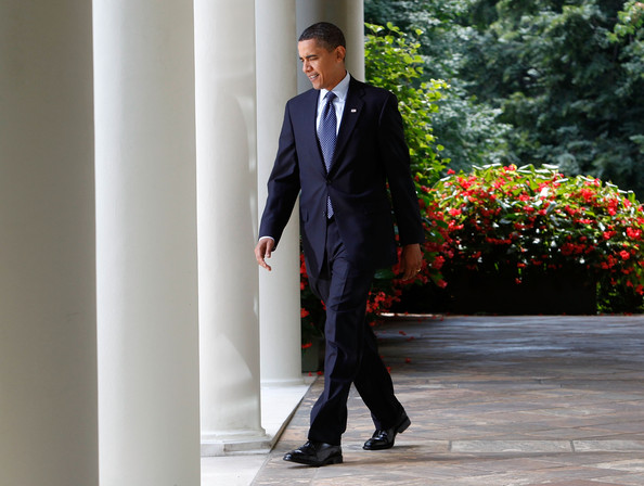 U.S. President Barack Obama walks in the Rose Garden at the White House on July 21, 2009 in Washington, DC. Obama announced that he wants to work with Congress to craft the best measure possible on health care reform.
