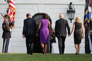 U.S. President Barack Obama, first lady Michelle Obama, Vice President Joseph Biden, his wife Jill Biden return to the White House after they observed a moment of silence to mark the 12th anniversary of the 9/11 attacks September 11, 2013 on the South Lawn of the White House in Washington, DC. The nation is commemorating the anniversary of the 2001 attacks which resulted in the deaths of nearly 3,000 people after two hijacked planes crashed into the World Trade Center, one into the Pentagon in Arlington, Virginia and one crash landed in Shanksville, Pennsylvania.