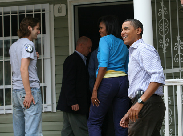 (AFP OUT) U.S. President Barack Obama (R) and first lady Michelle Obama (2nd-R) arrive to paint in a house being built by Habitat for Humanity on September 11, 2009 in Washington, DC. In observance of the eighth anniversary of the 9/11 terrorist attack, the Obamas participated in the community service activity after attending a moment of silence for 9/11 victims on the South Lawn of the White House.