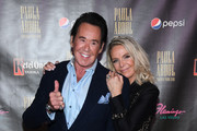 """Entertainer Wayne Newton (L) and his wife Kathleen McCrone attend the official opening of Paula Abdul's Flamingo Las Vegas residency """"Paula Abdul: Forever Your Girl"""" at The Cromwell Las Vegas on October 24, 2019 in Las Vegas, Nevada."""