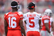 Quarterbacks J.T. Barrett #16 of the Ohio State Buckeyes and Braxton Miller #5 of the Ohio State Buckeyes who are both injured watch their teammates during the annual Ohio State Spring Game at Ohio Stadium on April 18, 2015 in Columbus, Ohio.