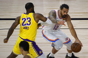 Steven Adams #12 of the Oklahoma City Thunder is defended by LeBron James #23 of the Los Angeles Lakers during the second quarter at HP Field House at ESPN Wide World Of Sports Complex on August 05, 2020 in Lake Buena Vista, Florida. NOTE TO USER: User expressly acknowledges and agrees that, by downloading and or using this photograph, User is consenting to the terms and conditions of the Getty Images License Agreement.