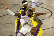 LeBron James #23 of the Los Angeles Lakers is defended by Luguentz Dort #5 of the Oklahoma City Thunder during the first quarter at HP Field House at ESPN Wide World Of Sports Complex on August 05, 2020 in Lake Buena Vista, Florida. NOTE TO USER: User expressly acknowledges and agrees that, by downloading and or using this photograph, User is consenting to the terms and conditions of the Getty Images License Agreement.