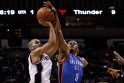 Tony Parker #9 of the San Antonio Spurs is blocked by Russell Westbrook #0 of the Oklahoma City Thunder in the first quarter in Game One of the Western Conference Finals of the 2012 NBA Playoffs at AT&T Center on May 27, 2012 in San Antonio, Texas. NOTE TO USER: User expressly acknowledges and agrees that, by downloading and or using this photograph, user is consenting to the terms and conditions of the Getty Images License Agreement.