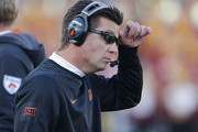 Head coach Mike Gundy of the Oklahoma State Cowboys coaches from the sidlines in the first half of play against the Iowa State Cyclones at Jack Trice Stadium on November 14, 2015 in Ames, Iowa. The Oklahoma State Cowboys defeated Iowa State 35-31.