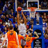 Mitchell Solomon Photos - Perry Ellis #34 of the Kansas Jayhawks shoots as Mitchell Solomon #41 and Jeff Newberry #22 of the Oklahoma State Cowboys defend during the game at Allen Fieldhouse on February 15, 2016 in Lawrence, Kansas. - Oklahoma State v Kansas