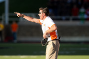 Head coach Mike Gundy of the Oklahoma State Cowboys debates a call during the game against the Texas Tech Red Raiders on October 31, 2015 at Jones AT&T Stadium in Lubbock, Texas. Oklahoma State defeated Texas Tech 70-53.